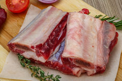 Raw beef ribs. With rosemary and thyme - ready for cooking Stock Photos