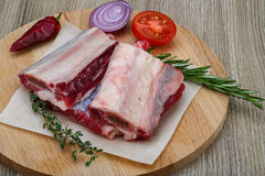Raw beef ribs. With rosemary and thyme - ready for cooking Royalty Free Stock Image