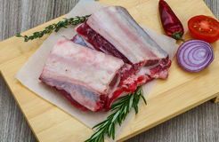 Raw beef ribs. With rosemary and thyme - ready for cooking Stock Photo