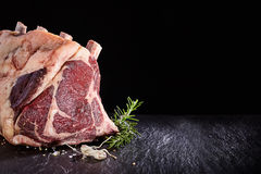 Raw beef ribs and seasoning over black background Royalty Free Stock Photo