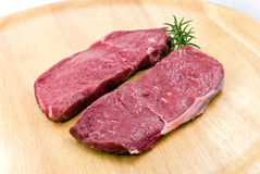 Raw beef-roast beef meat steak on the wooden backg Stock Image