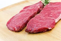 Raw beef-roast beef meat steak on the wooden backg Royalty Free Stock Images