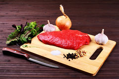 Raw Beef Roast with Fresh Herbs - Stock Image Stock Images