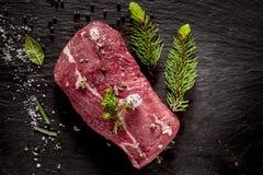 Free Raw Beef Roast Seasoned With Fresh Herbs Stock Photography - 55035252