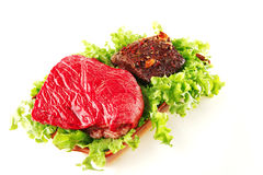 Raw beef with roast steak Royalty Free Stock Image