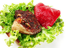 Raw beef with roast steak Stock Images