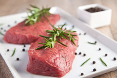 Raw beef with rosemary Royalty Free Stock Image