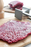 Raw beef round steak and pounder Royalty Free Stock Photography
