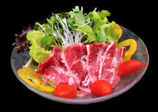 Raw beef with salad Stock Photos
