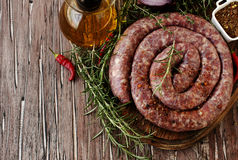 Raw beef sausages on a cast-iron pan,  selective focus Royalty Free Stock Photo