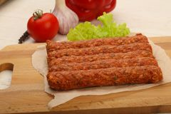 Raw beef sausages. For grill Stock Photos