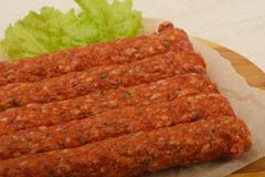 Raw beef sausages. For grill Royalty Free Stock Images