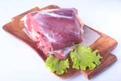 Raw beef shanks and lettuce leaf on wooden desk isolated on white background from above and copy space. ready for Stock Images