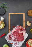 Raw beef sirloin with apple dressing and cucumber pickle Stock Photo