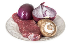 Raw Beef Sirloin Steak Red Raw Onion with Brown Mushrooms Royalty Free Stock Photography