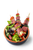 Raw beef skewers, isolated background. Raw beef skewers, with fresh vegetables and white background Royalty Free Stock Photos