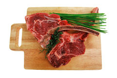 Raw beef spare ribs with thyme. Fresh meat : raw beef spare ribs with thyme and green chives on wooden board isolated over white background Stock Images