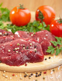 Raw beef with spices Royalty Free Stock Images