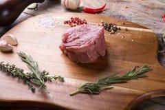 Raw beef sreak. On a wooden board Stock Photos