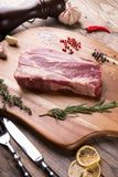 Raw beef sreak. On a wooden board Royalty Free Stock Photography