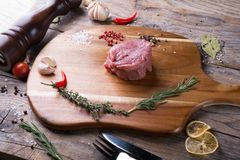 Raw beef sreak. On a wooden board Stock Images