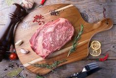 Raw beef sreak. On a wooden board Stock Photography