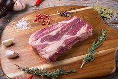 Raw beef sreak. On a wooden board Stock Photo