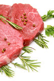 Raw beef steak. Fresh and raw beef steak with green herbs Stock Photos