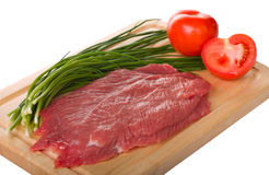 Raw beef steak. On cutting board isolated on white background Stock Photography