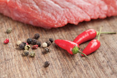 Raw beef steak and chilli pepper Stock Images