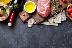 Raw beef steak cooking Royalty Free Stock Photos