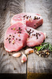 Raw beef steak. On a dark wooden table Stock Photography
