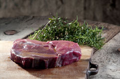 Raw beef steak on a dark wooden table Royalty Free Stock Image