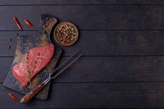 Raw beef steak and fork Royalty Free Stock Photo