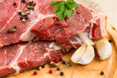 Raw beef steak with garlic Stock Photo