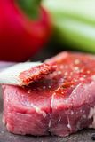 Raw beef steak, greased tomato sauce brush, cooking delicious Stock Images