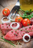 Raw beef steak with green pepper Stock Images