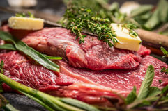 Raw beef steak with herbs and butter for grill or cooking Royalty Free Stock Images