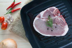 Raw beef steak with ingredient on a pan. View top Stock Photo