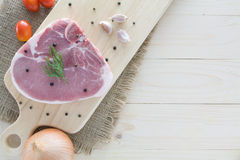 Raw beef steak with ingredient on a wooden table Royalty Free Stock Photo