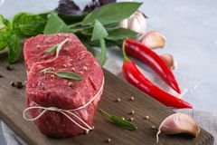 Raw beef steak with ingredients for cooking. On cutting board Stock Photos