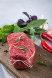 Raw beef steak with ingredients for cooking. On cutting board Stock Photography