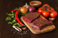 Raw beef steak with ingredients for cooking. On wooden Boards Stock Photo