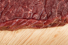 Raw beef steak meat. On kitchen board close up Stock Photo