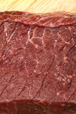 Raw beef steak meat. On kitchen board close up Stock Photos