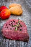 Raw beef steak on old wood Royalty Free Stock Images