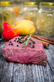 Raw beef steak on old wood Stock Photography