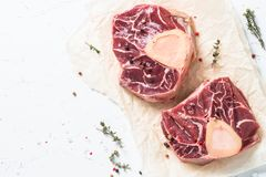Raw beef steak osso bucco. Marble meat. Top view with copy space on white table Stock Photo