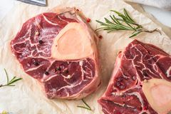 Raw beef steak osso bucco. Marble meat. Top view on white. Close up Stock Images