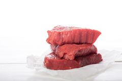 Raw beef steak over white Royalty Free Stock Image